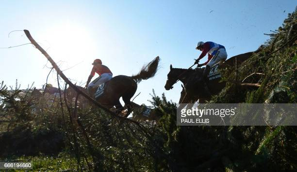 Jockey Derek Fox One for Arthur jumps 'The Chair' before going on to win the Grand National horse race on the final day of the Grand National...