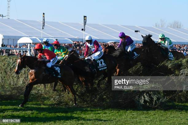 Jockey Derek Fox One for Arthur jumps 'The Chair' on the first lap before going on to win the Grand National horse race on the final day of the Grand...