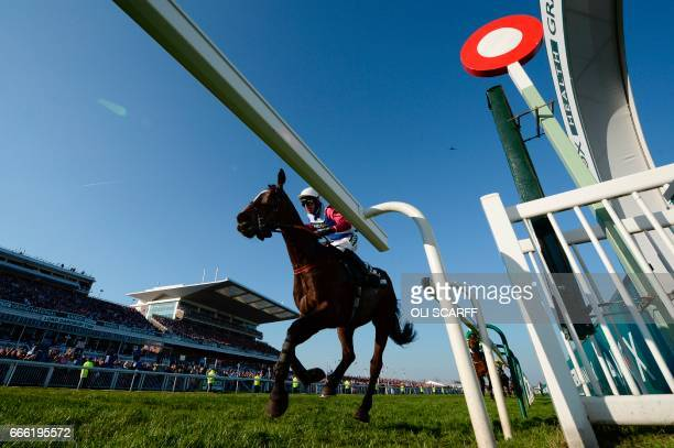 Jockey Derek Fox rides One for Arthur accross the finish line to win the Grand National horse race on the final day of the Grand National Festival...