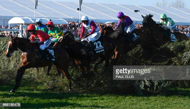 Jockey Derek Fox rides One for Arthur over 'The Chair' before going on to win the Grand National horse race on the final day of the Grand National...