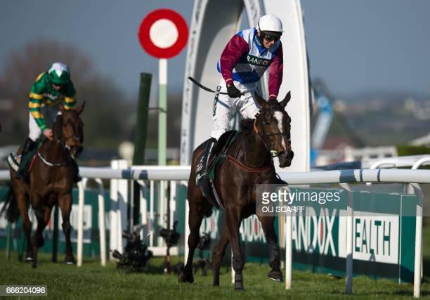 Jockey Derek Fox rides One for Arthur to win the Grand National horse race on the final day of the Grand National Festival horse race meeting at...