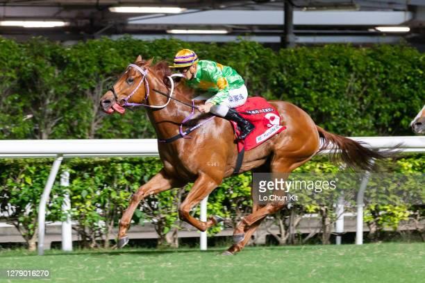Jockey Derek Leung Ka-chun riding Classic Unicorn wins the Race 8 High Island Handicap at Happy Valley Racecourse on October 7, 2020 in Hong Kong.