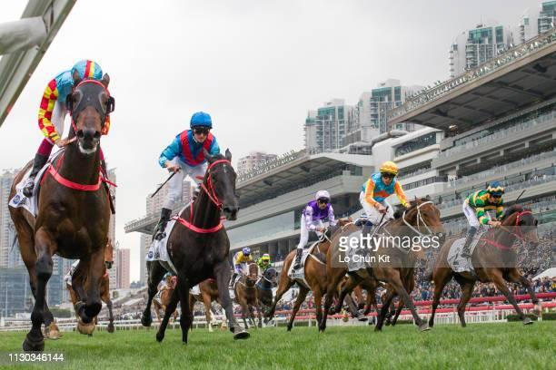 Jockey Derek Leung Kachun riding Mission Tycoon wins Race 9 The Hong Kong Classic Cup at Sha Tin racecourse on February 17 2019 in Hong Kong Dark...