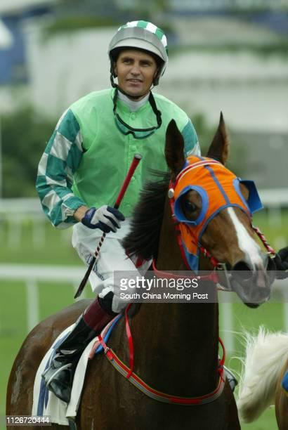 Jockey Dwayne Dunn mounts Congee King to return after winning the Race 4 at Sha Tin Racecourse 18 May 2003