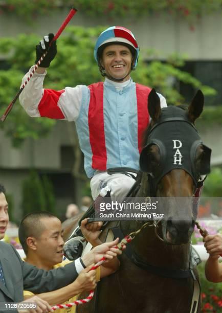 Jockey Dwayne Dunn mounts Dongguan Excels to return after winning the Race 5 at Sha Tin Racecourse 18 May 2003