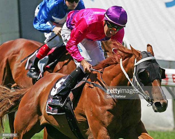 Jockey Dwayne Dunn rides Arclace to win race 4 Pages Event Equipment Handicap during the Moonee Valley Racing Club Christmas at the Valley meeting...
