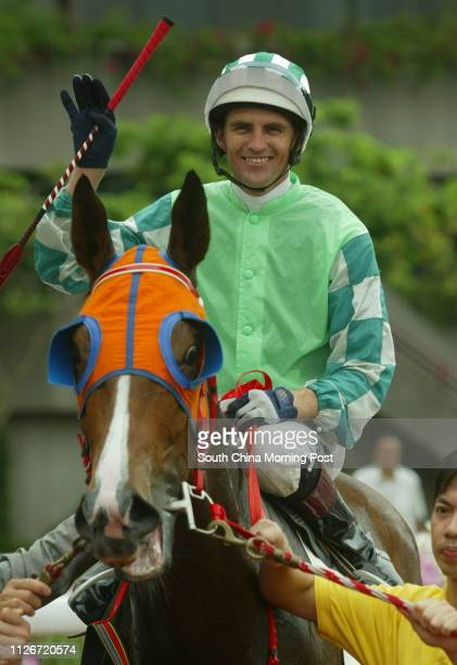 Jockey Dwayne Dunn waving to supporters after mounting Congee King to win the Race 4 at Sha Tin Racecourse 18 May 2003