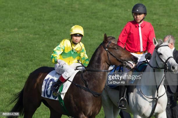 Jockey Dylan Mo Hintung riding Flying Godspell wins Race 5 Carnarvon Handicap at Sha Tin racecourse on December 3 2017 in Hong Kong Hong Kong