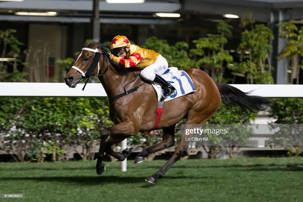 Jockey Dylan Mo Hin-tung riding Happy Friendship wins the Race 1 Rose Handicap at Happy Valley Racecourse on February 14, 2018 in Hong Kong, Hong Kong.