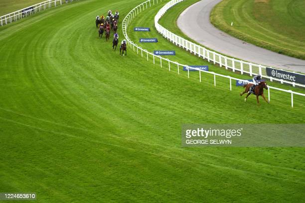 Jockey Emmet McNamara rides Serpentine into a clear lead around Tattenham Corner on their way to victory in the Derby Stakes at the Epsom Derby...