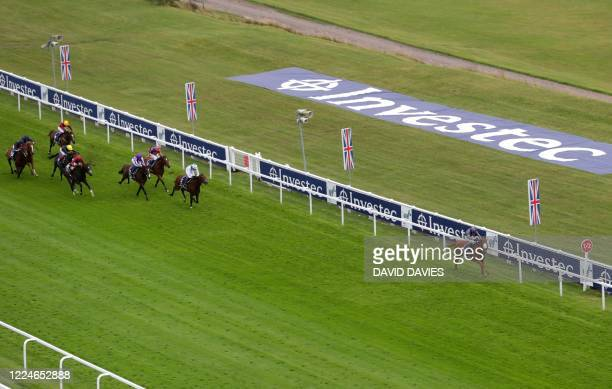 Jockey Emmet McNamara rides Serpentine to a five and a half lengths victory in the Derby Stakes at the Epsom Derby Festival south of London on July 4...