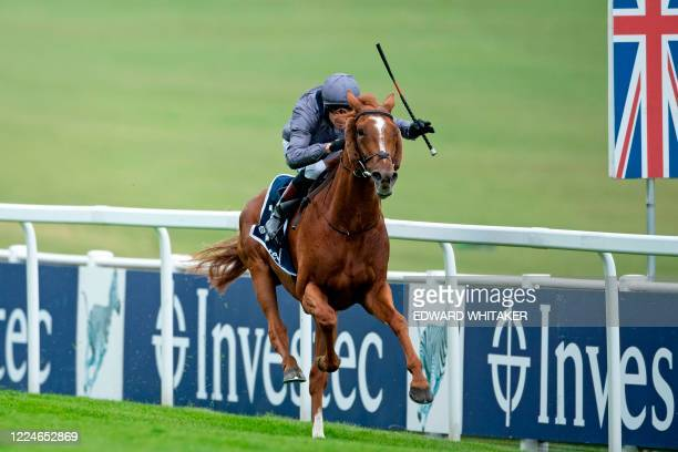 Jockey Emmet McNamara rides Serpentine to victory in the Derby Stakes at the Epsom Derby Festival south of London on July 4 2020 The Epsom Derby and...