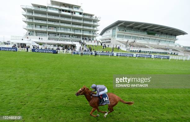 Jockey Emmet McNamara rides Serpentine to victory in the Derby Stakes at the Epsom Derby Festival, south of London on July 4, 2020. - The Epsom Derby...