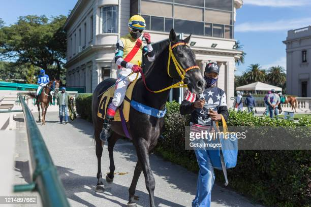 A jockey enters the race track prior to the competition day as Uruguay slowly returns to normal due to coronavirus outbreak at Maroñas Horse Track on...
