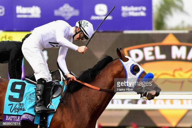 Jockey Flavien Prat celebrates after riding Battle Of Midway to a win in the Las Vegas Breeder's Cup Dirt Mile on day one of the 2017 Breeder's Cup...