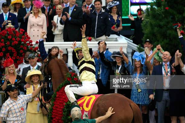 Jockey Flavien Prat celebrates atop of Country House after winning the 145th running of the Kentucky Derby at Churchill Downs on May 04 2019 in...