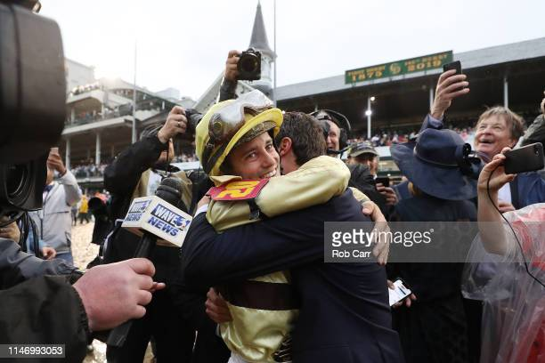 Jockey Flavien Prat celebrates with the connections of Country House after winning the 145th running of the Kentucky Derby at Churchill Downs on May...