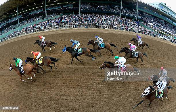 Jockey Florent Geroux atop Work All Work leads the pack en route to winning the 2014 Xpressbet Breeders' Cup Sprint at Santa Anita Park on November 1...