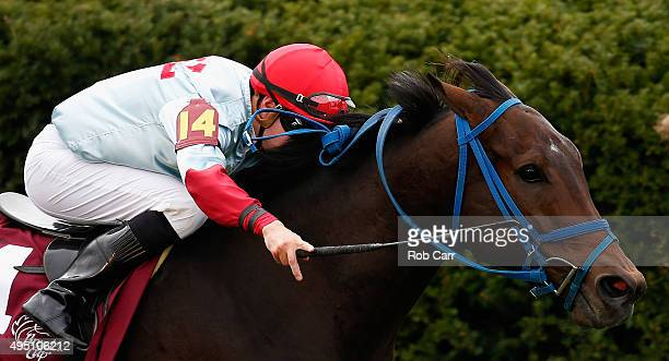 Jockey Florent Geroux rides Mongolian Saturday to win the Breeders' Cup Turf Sprint at Keeneland Racecourse on October 31, 2015 in Lexington,...