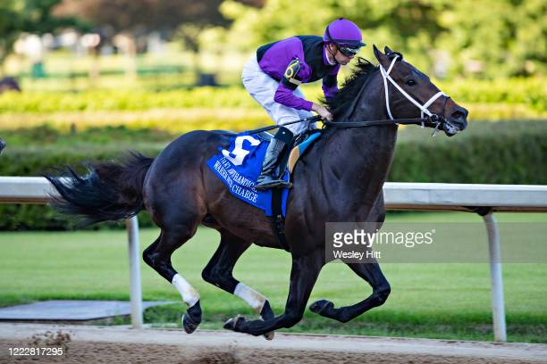Jockey Florent Geroux rides Warrioru2019s Charge to the lead at the start of The Oaklawn Handicap at Oaklawn Racing Casino Resort on Derby Day during...