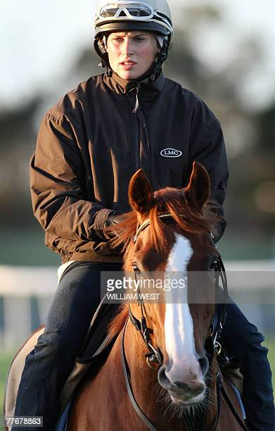 Jockey Francesca Cumani rides British horse Purple Moon during early morning trackwork in preparartion for the Melbourne Cup in Melbourne 05 November...