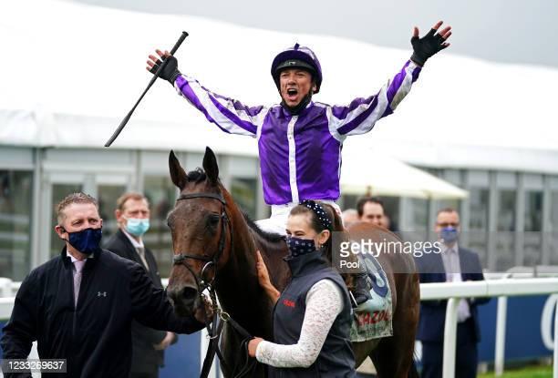Jockey Frankie Dettori celebrates after winning the Cazoo Oaks race with Snowfall at Epsom Racecourse on June 4, 2021 in Epsom, England.
