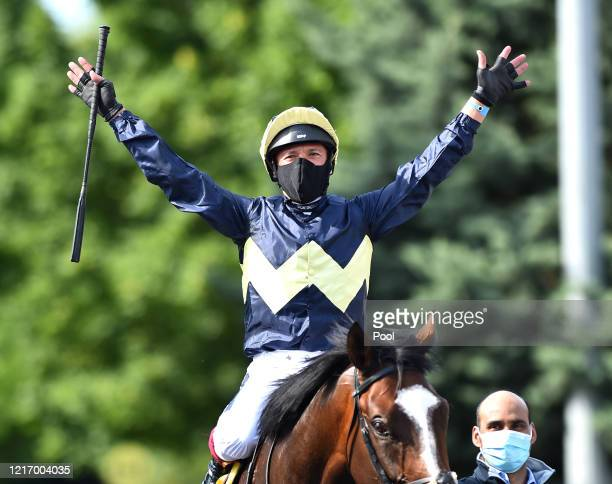 Jockey Frankie Dettori celebrates after winning the Unibet Casino Deposit 10 Get 40 Bonus Maiden Stakes race with the horse Galsworthy at Kempton...