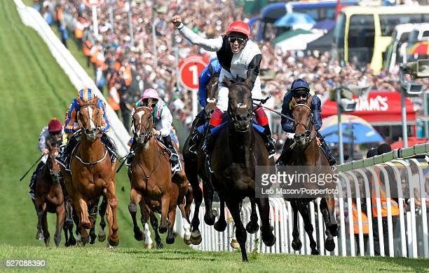 Jockey Frankie Dettori celebrates on Golden Horn moments after finishing in first place to win the 2015 Investec Derby race at Epsom Downs racecourse...