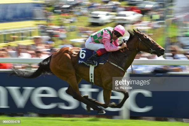 Jockey Frankie Dettori cruises to victory on Wilamina in the Princess Elizabeth Stakes on the second day of the Epsom Derby Festival in Surrey,...