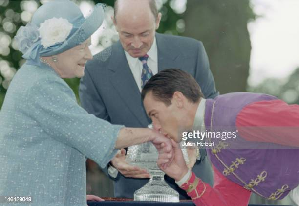 Jockey Frankie Dettori kissing the hand of the Queen Mother at Ascot 21st June 1997