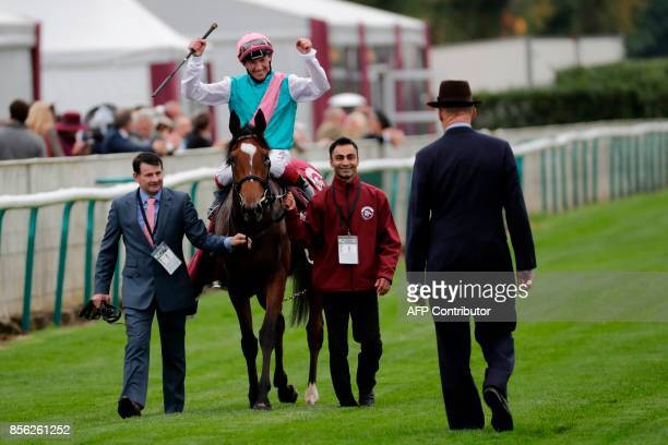 Jockey Frankie Dettori on his horse Enable owned Prince Khalid Abdullah reacts after winning the 96th Qatar Prix de l'Arc de Triomphe horse race at...