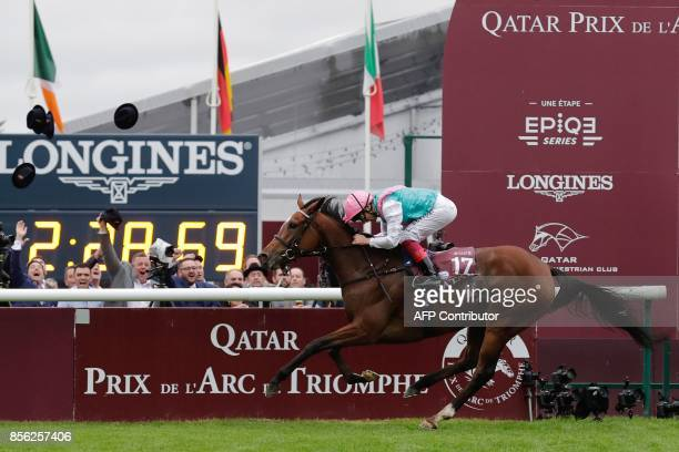 Jockey Frankie Dettori on his horse Enable races to win the Qatar Prix de l'Arc de Triomphe horse race at the Chantilly racecourse north of Paris on...