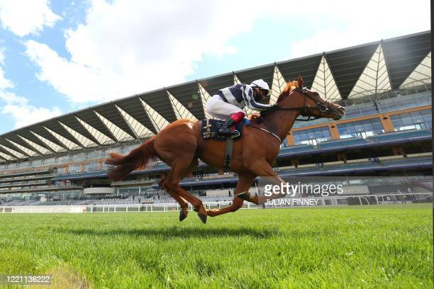 Jockey Frankie Dettori rides Alpine Star to win The Coronation Stakes on day five of the Royal Ascot horse racing meet, in Ascot, west of London, on...