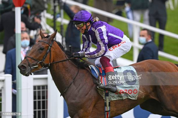 Jockey Frankie Dettori rides Snowfall past the winning post for an easy victory in the Oaks on the first day of the Epsom Derby Festival horse racing...