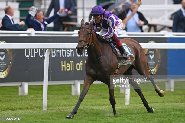 Jockey Frankie Dettori rides Snowfall to an easy victory in the Oaks on the first day of the Epsom Derby Festival horse racing event in Surrey,...