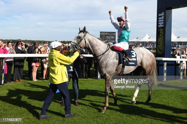 Jockey Frankie Dettori riding Logician celebrates after winning the William Hill St Leger Stakes during St Leger Day at Doncaster Racecourse on...