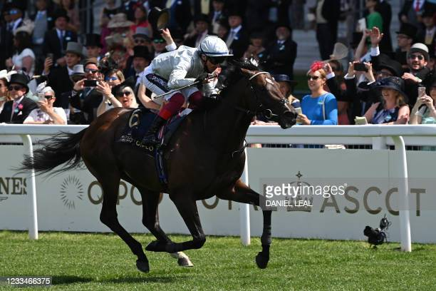 Jockey Frankie Dettori riding Palace Pier wins the Queen Anne stakes on the first day of the Royal Ascot horse racing meet, in Ascot, west of London...