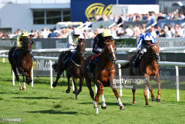 Jockey Frankie Dettori riding Stradivarius wins the Magners Rose Doncaster Cup Stakes during Gentlemen's day at Doncaster Racecourse on September 13,...