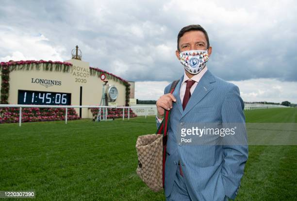 Jockey Frankie Dettori wears a protective mask as he arrives at Ascot Racecourse on June 16 2020 in Ascot England