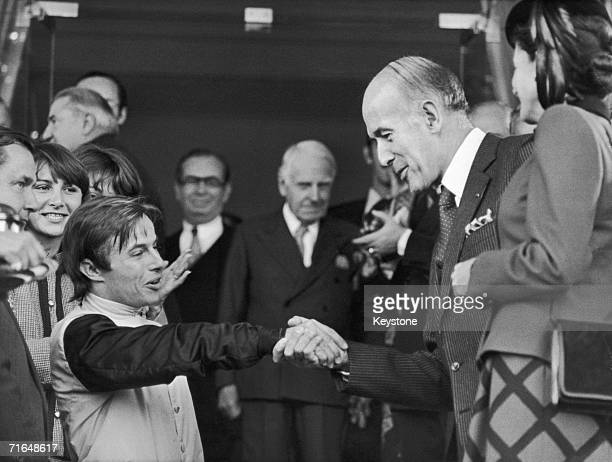 Jockey Freddy Head receives the congratulations of French president Valery Giscard d'Estaing and his wife AnneAymone after winning the Prix de l'Arc...