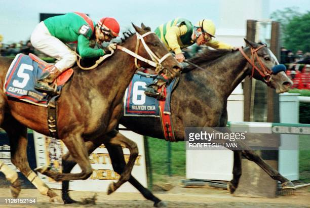 Jockey Gary Stevens aboard Silver Charm beats Captain Bodgit with Alex Solis aboard in a photo finish in the 123rd running of the Kentucky Derby 03...