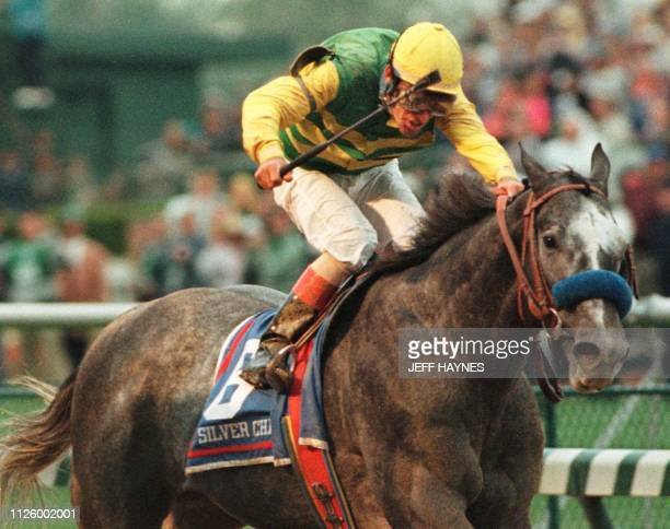 Jockey Gary Stevens aboard Silver Charm crosses the finish line beating Captain Bodgit in a photo finish in the 123rd running of the Kentucky Derby...