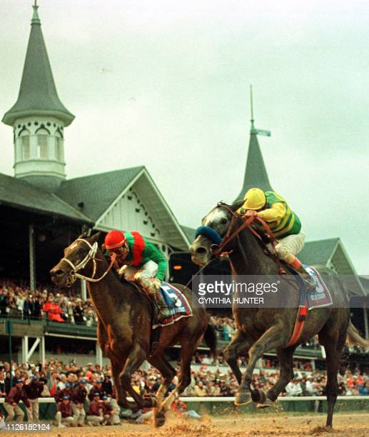 Jockey Gary Stevens aboard Silver Charm thunders down the final stretch to beat Captain Bodgit with Alex Solis aboard in a photo finish in the 123rd...