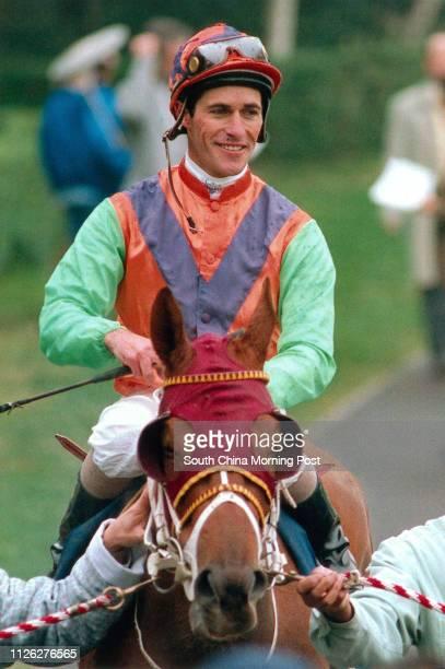 Jockey Gary Stevens on horse no6 Pocket Full returns to scales after winning the race 3 at Sha Tin racecourse 26 February 1995