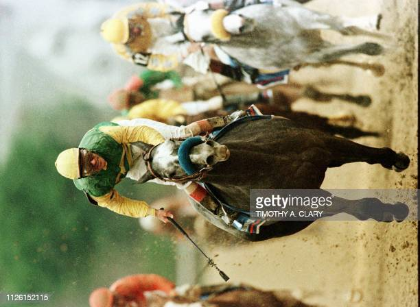 Jockey Gary Stevens races down the final stretch aboard Silver Charm to win the 123rd Kentucky Derby at Churchill Downs in Louisville Kentucky 03 May...