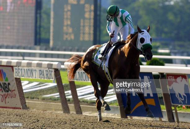 Jockey Gary Stevens riding Point Given looks over his shoulder as he crosses the finish line well ahead of any other horse in the 133rd running of...