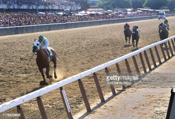Jockey Gary Stevens riding Point Given nears the finish line far ahead of any other horse in the 133rd running of the Belmont Stakes 09 June 2001 in...