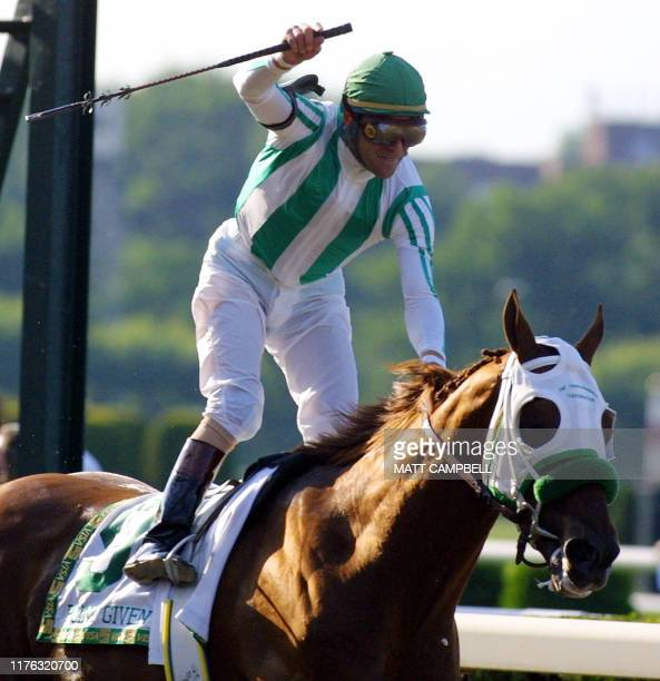 Jockey Gary Stevens riding Point Given raises his arm in the air after crossing the finish line well ahead of any other horse in the 133rd running of...