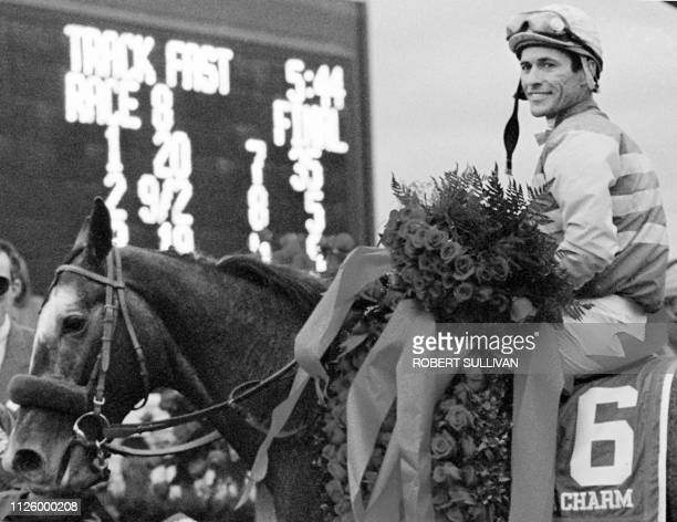 Jockey Gary Stevens winner of the Kentucky Derby aboard Silver Charm poses for photographers after winning the 123rd running 03 May at Churchill...