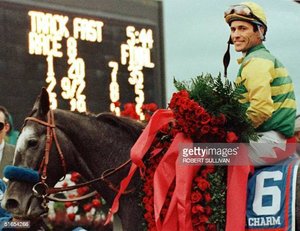 Jockey Gary Stevens winner of the Kentucky Derby aboard Silver Charm poses for photographers after winning the 123rd Kentucky Derby 03 May at...